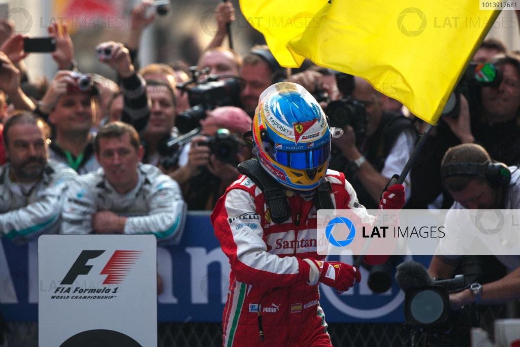 Shanghai International Circuit, Shanghai, China Sunday 14th April 2013 Fernando Alonso, Ferrari, 1st position, celebrates upon arrival in Parc Ferme. World Copyright: Andy Hone/LAT Photographic ref: Digital Image HONZ7766