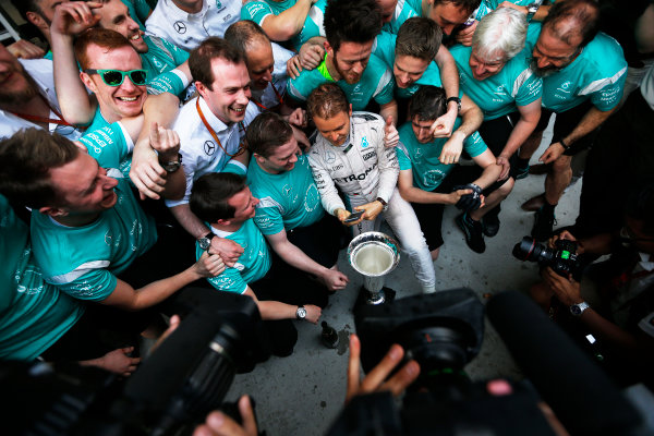 Shanghai International Circuit, Shanghai, China. Sunday 17 April 2016. Nico Rosberg, Mercedes AMG, 1st Position, and the Mercedes team celebrate with the winners trophy. World Copyright: Sam Bloxham/LAT Photographic ref: Digital Image _R6T1927