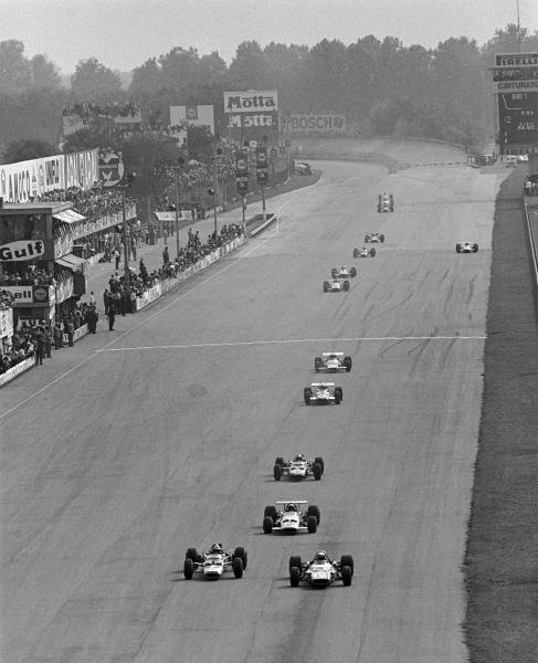 End of the first lap, Eventual winner Jackie Stewart(GBR) Matra MS80 is neck and neck with 2nd placed Jochen Rindt(AUT) Lotus 49B followed by Bruce Mclaren(NZL) Mclaren M7C Italian GP, Monza, 8 September 1969