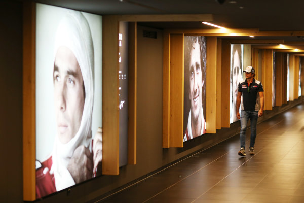 Red Bull Ring, Spielberg, Austria. Sunday 9 July 2017. Carlos Sainz Jr, Toro Rosso, walks through a hall of fame. World Copyright: Charles Coates/LAT Images ref: Digital Image AN7T3445