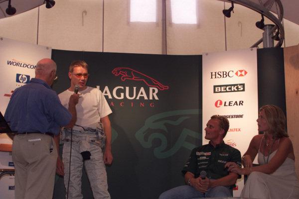 Mika Hakkinen (McLaren Mercedes) is interviewed by Murray Walker, in commemorating Johnny Herbert's last Grand Prix.World Copyright - LAT Photographicref: digital image