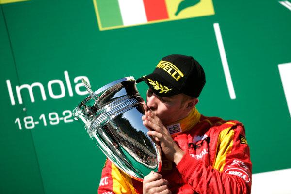 Imola, Italy. 20th March 2011. Sunday Race.Dani Clos, (ESP, Racing Engineering) celebrates victory on the podium. Portrait.     World Copyright: Drew Gibson/GP2 Media Service.ref: Digital Image _Y8P0564