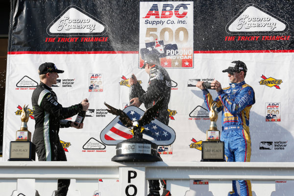 Verizon IndyCar Series ABC Supply 500 Pocono Raceway, Long Pond, PA USA Sunday 20 August 2017 Will Power, Team Penske Chevrolet, Josef Newgarden, Team Penske Chevrolet, Alexander Rossi, Curb Andretti Herta Autosport with Curb-Agajanian Honda celebrate with champagne on the podium World Copyright: Phillip Abbott LAT Images ref: Digital Image abbott_pocono_0817_8078