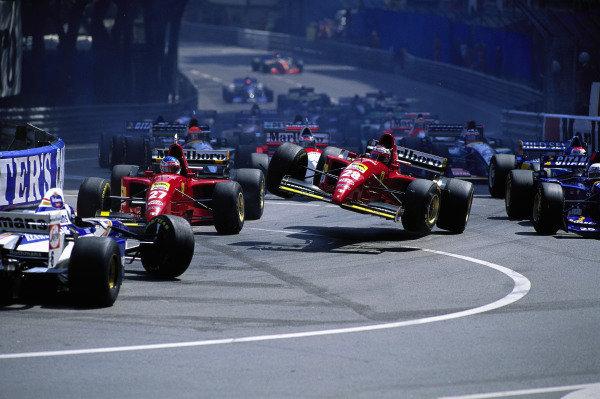 David Coulthard, Williams FW17 Renault, Jean Alesi, Ferrari 412T2, and Gerhard Berger, Ferrari 412T2, crash out at the start.