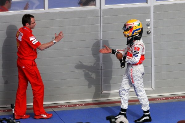 (L to R): Stefano Domenicali (ITA) Ferrari Manager of F1 Operations with Lewis Hamilton (GBR) McLaren. Formula One World Championship, Rd 3, Bahrain Grand Prix, Race, Bahrain International Circuit, Bahrain, Sunday 6 April 2008.
