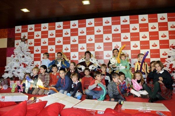 The three wise men (l-r): Marc Gene (ESP) Ferrari test driver; Fernando Alonso (ESP), Ferrari, and Pedro De la Rosa (ESP), HRT Formula 1 Team.Santander Christmas Festivities, Madrid, Spain, Monday 19 December 2011. *** Local Caption *** RUBIO