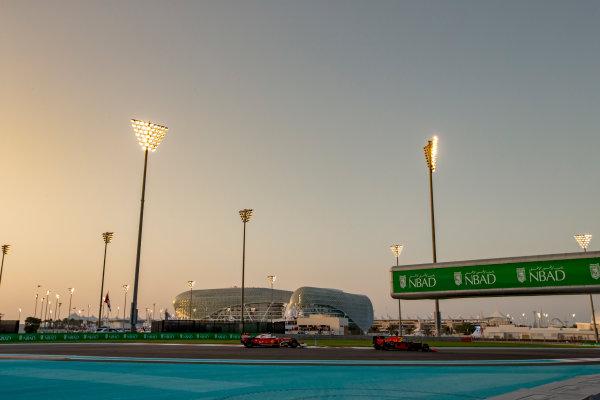 Yas Marina Circuit, Abu Dhabi, United Arab Emirates. Sunday 27 November 2016. Daniel Ricciardo, Red Bull Racing RB12 TAG Heuer, leads Sebastian Vettel, Ferrari SF16-H. World Copyright: Zak Mauger/LAT Photographic ref: Digital Image _X0W9096
