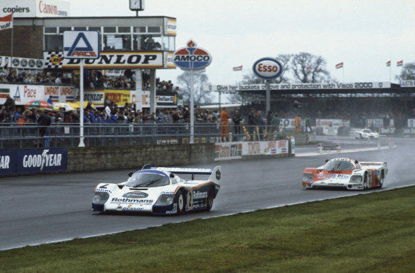 Silverstone, England. 8th May 1983. Rd 2.Stefan Bellof/Derek Bell (Porsche 956), 1st position, leads Alan Jones/Vern Schuppan (Porsche 956), 5th position, action. World Copyright: LAT Photographic.Ref:  83SIL03