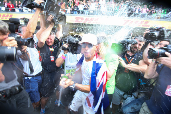 Autodromo Hermanos Rodriguez, Mexico City, Mexico. Sunday 29 October 2017. Lewis Hamilton, Mercedes AMG, sprays Champagne at photographers in celebration of securing his 4th world drivers championship title. World Copyright: Charles Coates/LAT Images  ref: Digital Image DJ5R7718