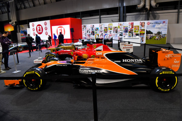 Autosport International Exhibition. National Exhibition Centre, Birmingham, UK. Thursday 11th January 2017. A line-up of cars, including a McLaren and Ferrari, on the F1 Racing Stand.World Copyright: Mark Sutton/Sutton Images/LAT Images Ref: DSC_7084