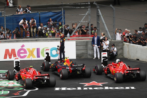 Max Verstappen, Red Bull Racing RB14, celebrates winning the race in parc ferme with Sebastian Vettel, Ferrari SF71H, and Kimi Raikkonen, Ferrari SF71H