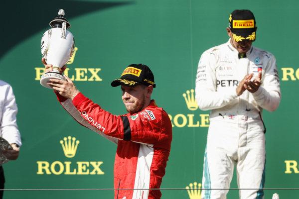 Sebastian Vettel, Ferrari celebrates on the podium with champagne.
