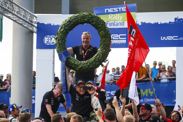 Toyota WRC Team Principal Tommi Makinen celebrates Ott Tanak's victory on Rally Finland