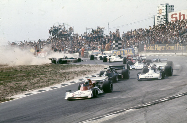 Brett Lunger, Surtees TS19 Ford leads Tom Pryce, Shadow DN5B Ford and Alan Jones, Surtees TS19 Ford as Guy Edwards, Hesketh 308D Ford spins in the background.