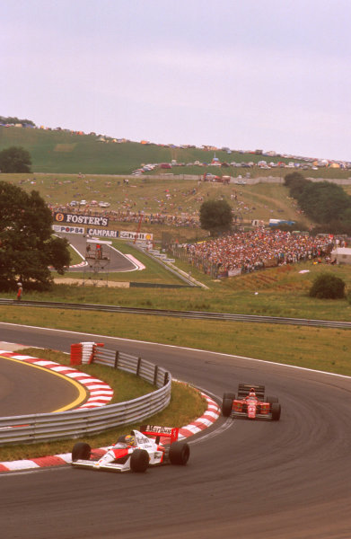 Hungaroring, Hungary. 11-13 August 1989. Ayrton Senna (McLaren MP4/5 Honda) leads Nigel Mansell (Ferrari 640). Ref-89 HUN 07. World Copyright - LAT Photographic