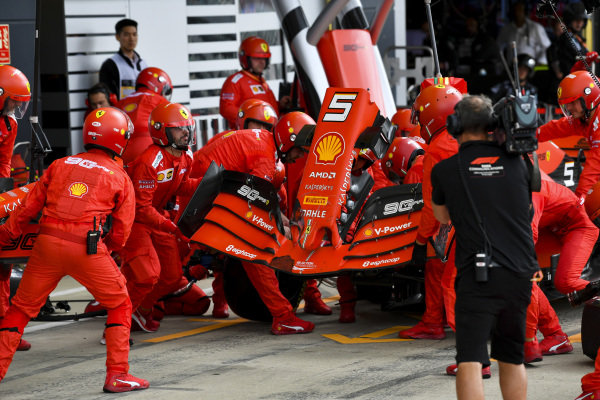 Sebastian Vettel, Ferrari SF90 pit stop for front wing change after contact with Max Verstappen, Red Bull Racing RB15