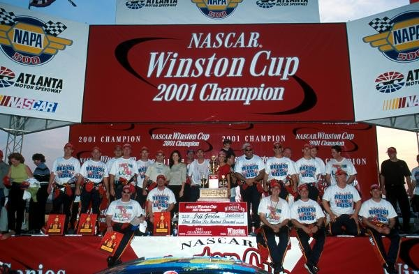 Jeff Gordon (USA) celebrates his fourth Winston Cup title with a little help from his friends. 