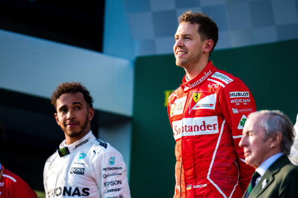 Lewis Hamilton (GBR) Mercedes AMG F1 and Sebastian Vettel (GER) Ferrari on the podium at Formula One World Championship, Rd1, Australian Grand Prix, Race, Albert Park, Melbourne, Australia, Sunday 26 March 2017.
