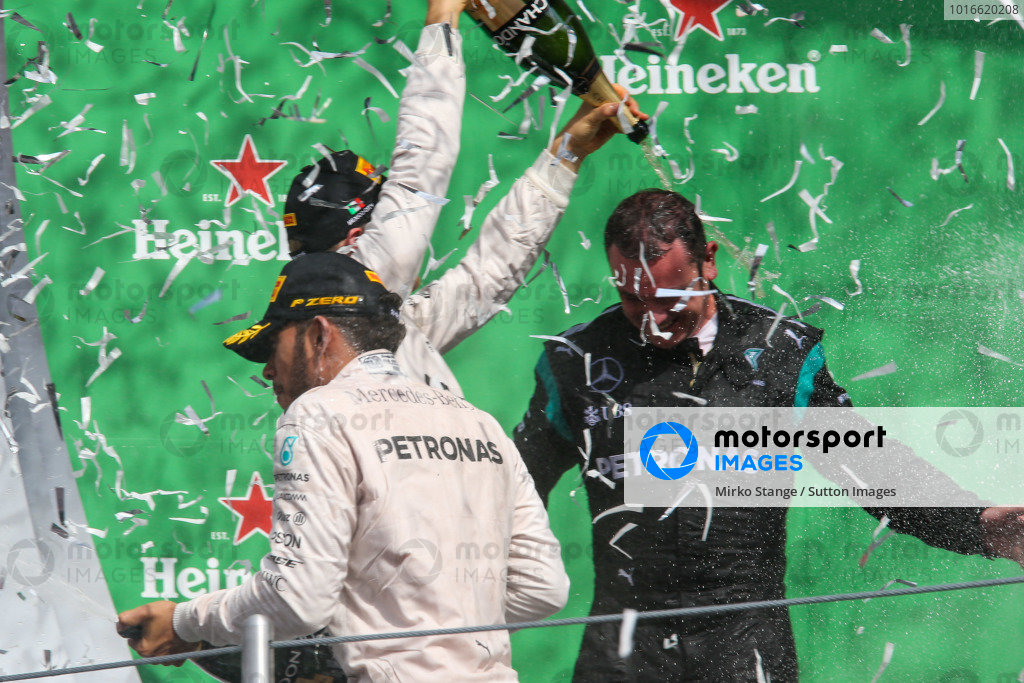 Nico Rosberg (GER) Mercedes AMG F1, Tom Walton (GBR) Mercedes AMG F1 Engineer and Lewis Hamilton (GBR) Mercedes AMG F1 celebrate on the podium with the champagne at Formula One World Championship, Rd19, Mexican Grand Prix, Race, Circuit Hermanos Rodriguez, Mexico City, Mexico, Sunday 30 October 2016.