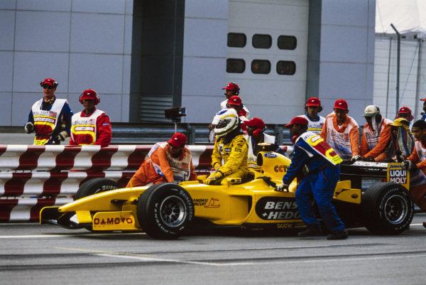 Giancarlo Fisichella, Jordan EJ13 Ford, is pushed by marshals.