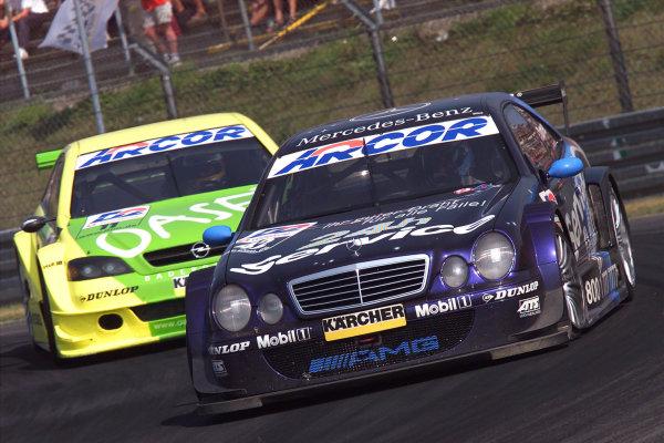 2001 DTM Championship.Nurburgring, Germany. 26th August 2001.Darren Turner (Rosberg Mercedes CLK) leads Michael Bartles (Holzer Opel Atra V8 Coupe).World Copyright: G. & H. M-ller/ LAT Photographicref: Digital Image Only