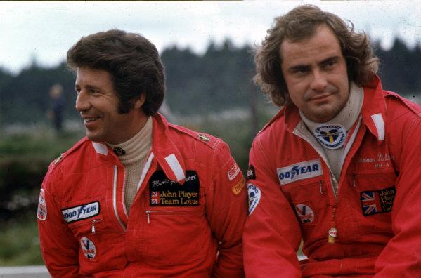 1977 Formula 1 World Championship.Lotus-Ford Cosworth team mates Mario Andretti and Gunnar Nilsson.Ref-A2A 09.World - LAT Photographic