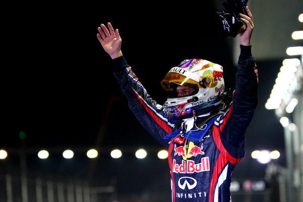 Marina Bay Circuit, Singapore.25th September 2011.Sebastian Vettel, Red Bull Racing RB7 Renault, 1st position, celebrates victory in Parc Ferme. Portrait. Helmets. Finish. World Copyright: Andy Hone/LAT Photographicref: Digital Image CSP28764