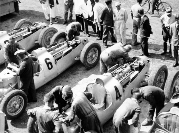 1936 Italian Grand Prix Monza, Italy. 13 September 1936 The Auto Union team in the paddock. The rear-engine C-type cars from left-to-right: Ernst von Delius, Achille Varzi, Bernd Rosemeyer and Hans Stuck, atmosphere World Copyright: Robert Fellowes/LAT PhotographicRef: 36ITA01