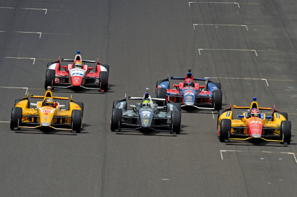 26 May, 2013, Indianapolis, Indiana, USA Flanked by 3rd place finisher Ryan Hunter-Reay (#1) and 2nd place Carlos Munoz (#26) winner Tony Kanaan (#11) celebrates his win. ©2013, F. Peirce Williams LAT Photo USA