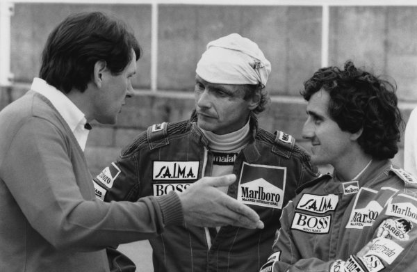 Brands Hatch, England. 20th - 22nd July 1984. John Barnard in conversation with Niki Lauda (McLaren MP4-2 TAG Porsche) 1st position and Alain Prost (McLaren MP4-2 TAG Porsche), retired portrait. World Copyright: LAT Photographic. Ref: B/W Print.