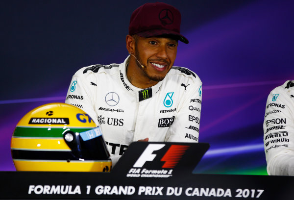 Circuit Gilles Villeneuve, Montreal, Canada. Saturday 10 June 2017. Lewis Hamilton, Mercedes AMG, shows off his Ayrton Senna helmet, a gift after equalling the Brazilian's pole record, in the post-qualifying press conference.  World Copyright: Andy Hone/LAT Images ref: Digital Image _ONY4910