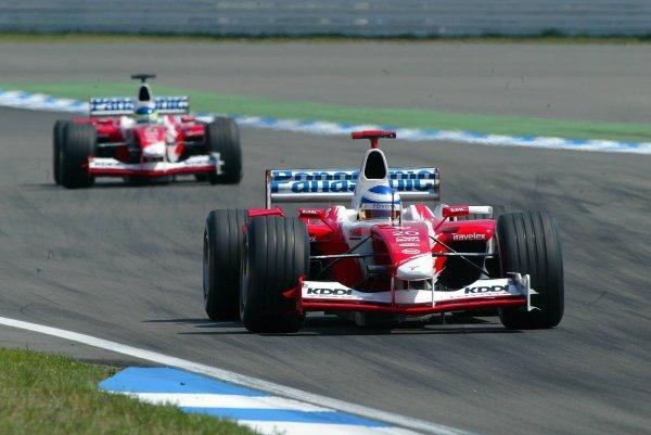 Fifth placed Olivier Panis (FRA) Toyota TF103 leads team mate Cristiano Da Matta (BRA) Toyota TF103, who finished sixth.Formula One World Championship, Rd12, German Grand Prix, Race Day, Hockenheim, Germany, 3 August 2003.DIGITAL IMAGE