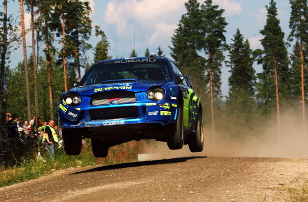 Petter Solberg (NOR) leaps his Subaru Impreza WRC on his way to a third place finish.FIA World Rally Championship, Rd9, Neste Rally Finland, Day Three, Finland. 11 August 2002.DIGITAL IMAGE