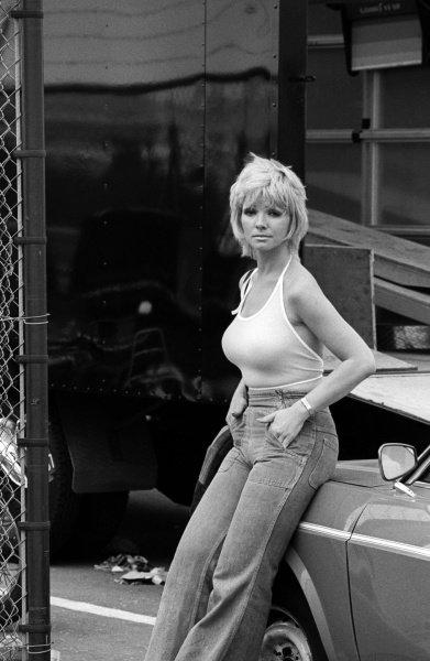 A woman in the paddock.Dutch Grand Prix, Rd 8, Zandvoort, Holland, 22 June 1975.