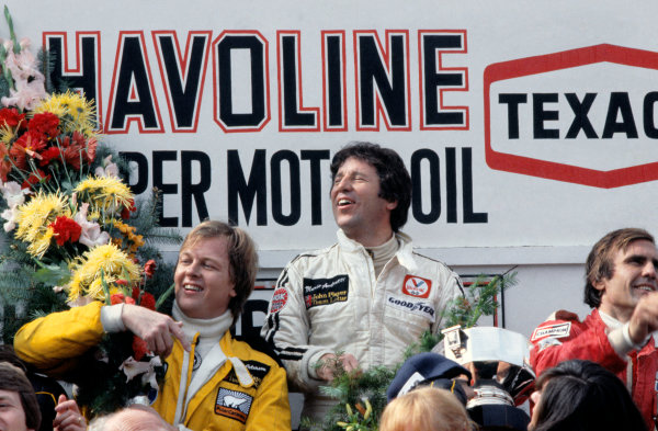 Zolder, Belgium. 19 - 21 May 1978. Mario Andretti (Lotus 79-Ford) 1st position, with Ronnie Peterson (Lotus 79-Ford), 2nd position and Carlos Reutemann (Ferrari 312T3) 3rd position on the podium, portrait.  World Copyright: LAT Photographic. Ref: 78BEL11