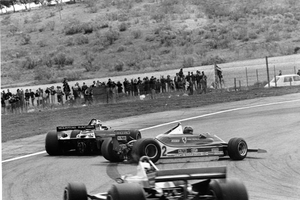 Jarama, Madrid, Spain. 27-29 April 1979. Gilles Villeneuve (Ferrari 312T4) 7th position, spins and is passed by Carlos Reutemann (Lotus 79-Ford) 2nd position, action. World Copyright - LAT Photographic. ref: 12413/14.