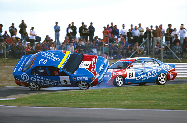 Silverstone, England. 9th - 11th July 1993.Julian Bailey, Toyota Carina E GTi, collides with team mate Will Hoy, Toyota Carina E GTi, at the support race to the 1993 British Grand Prix, action.World Copyright: LAT PhotographicRef: Colour Transparency