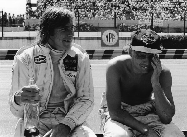 Buenos Aires, Argentina 19th - 21st January 1979. James Hunt (Wolf WR7-Ford), retired, shares a joke with Niki Lauda (Brabham BT48-Alfa), retired, in the pits, portrait.  World Copyright: LAT Photographic.  Ref:  12098 - 15.