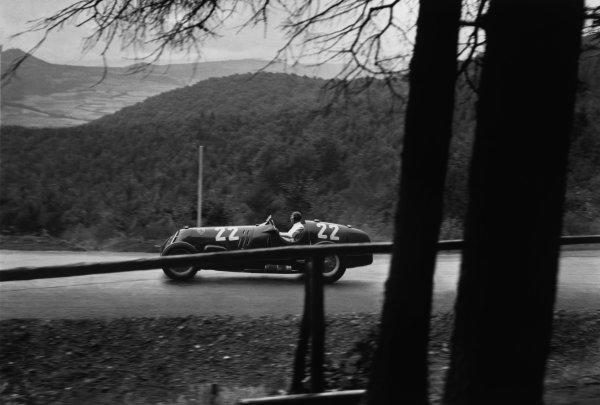 Nurburgring, Germany. 25 July 1937.Tazio Nuvolari (Alfa Romeo 12C), 4th position, action.World Copyright: Robert Fellowes/LAT PhotographicRef: RF37_GER_35