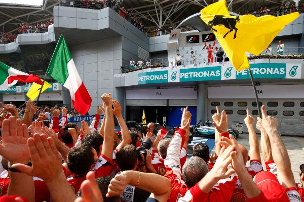 Sepang International Circuit, Sepang, Kuala Lumpur, Malaysia. Sunday 29 March 2015. Sebastian Vettel, Ferrari, 1st Position, arrives on the podium to the cheers of his Ferrari team. World Copyright: Andrew Hone/LAT Photographic. ref: Digital Image _ONY1031