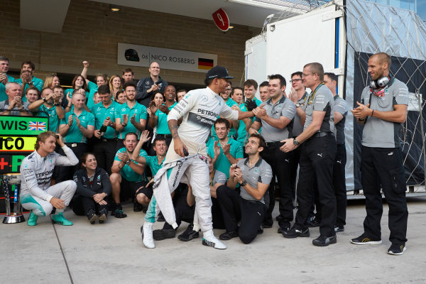 Circuit of the Americas, Austin, Texas, United States of America. Sunday 2 November 2014. Lewis Hamilton, Mercedes AMG celebrates with the team and Nico Rosberg, Mercedes AMG after winning the race. World Copyright: Steve Etherington/LAT Photographic. ref: Digital Image SNE10529