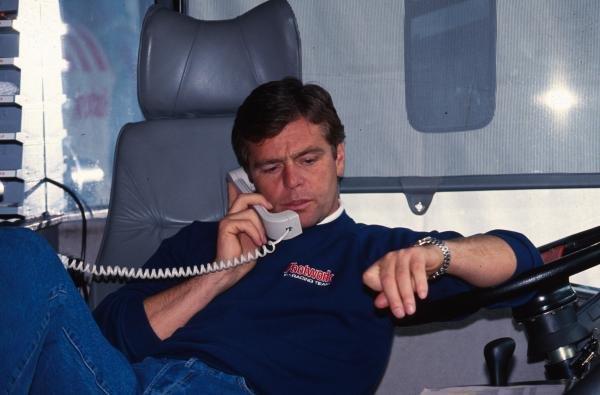 Derek Warick on the phone in the Footwork motorhome. German Grand Prix, Hockenheim, 25 July 1993