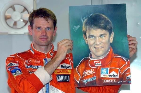 Marcus Gronholm (FIN) Peugeot with a portrait of himself.World Rally Championship, Rd11, Rally of Japan, Shakedown, Obihiro, Hokkaido, Japan, 2 September2004.DIGITAL IMAGE