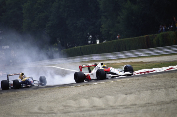 Ayrton Senna, McLaren MP4-6 Honda, locks a front brake ahead of Nigel Mansell, Williams FW14 Renault, at the first chicane.