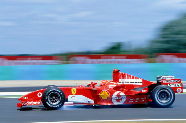 2005 French Grand Prix. Magny-Cours, France. 1st - 3rd July 2005 Michael Schumacher, Ferrari F2005. Action. World Copyright: Peter Spinney/LAT Photographic Ref: 35mm Image A09