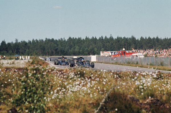 1973 Swedish Grand Prix.  Anderstorp, Sweden. 15-17th June 1973.  Ronnie Peterson, Lotus 72E Ford, 2nd position, leads Emerson Fittipaldi, Lotus 72E Ford, 12th position.  Ref: 73SWE04. World Copyright: LAT Photographic