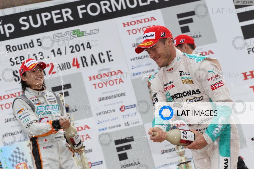 2014 Super Formula Series Autopolis, Japan. 13th - 14th September 2014. Rd 5. Winner Andre Lotterer ( #36 PETRONAS TOM'S SF14 ) 2nd position Yuji Kunimoto ( #39 P.MU / CERUMO?INGING SF14 ) 3rd position Joao Paulo de Oliveira ( #19 Lenovo TEAM IMPUL SF14 ) podium, portrait World Copyright: Masahide Kamio / LAT Photographic. Ref:  2014SF_Rd5_006.JPG