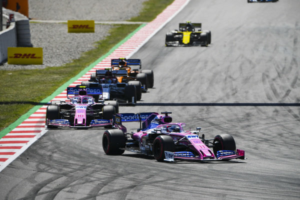 Sergio Perez, Racing Point RP19, leads Lance Stroll, Racing Point RP19, Antonio Giovinazzi, Alfa Romeo Racing C38, Lando Norris, McLaren MCL34, and Nico Hulkenberg, Renault R.S. 19
