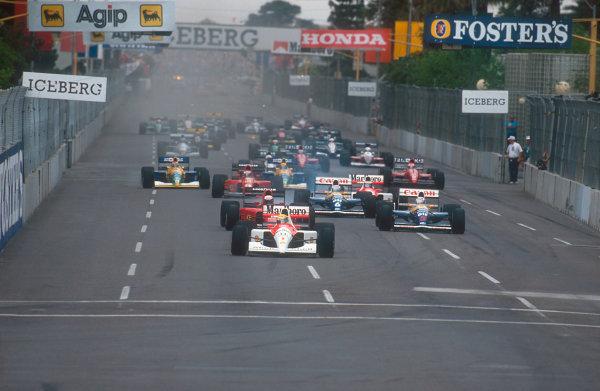 1991 United States Grand Prix.Phoenix, Arizona, U.S A.8-10 March 1991.Ayrton Senna (McLaren MP4/6 Honda) leads Alain Prost (Ferrari 642), Nigel Mansell, Riccardo Patrese (both Williams FW14 Renault's), Gerhard Berger (McLaren MP4/6 Honda), Jean Alesi (Ferrari 642), Nelson Piquet and Roberto Moreno (both Benetton B190B Ford's) at the start. Ref-91 USA 19.World Copyright - LAT Photographic