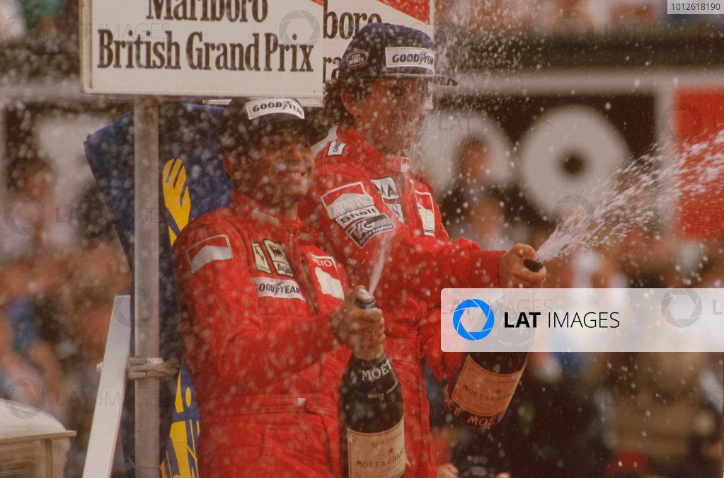 Silverstone, England.19-21 July 1985.Alain Prost (McLaren TAG Porsche) 1st position and Michele Alboreto (Ferrari) 2nd position on the podium.Ref-85 GB 07.World Copyright - LAT Photographic